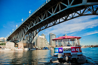 Aquabus on the water under Graville Street Bridge | by Tourism Vancouver