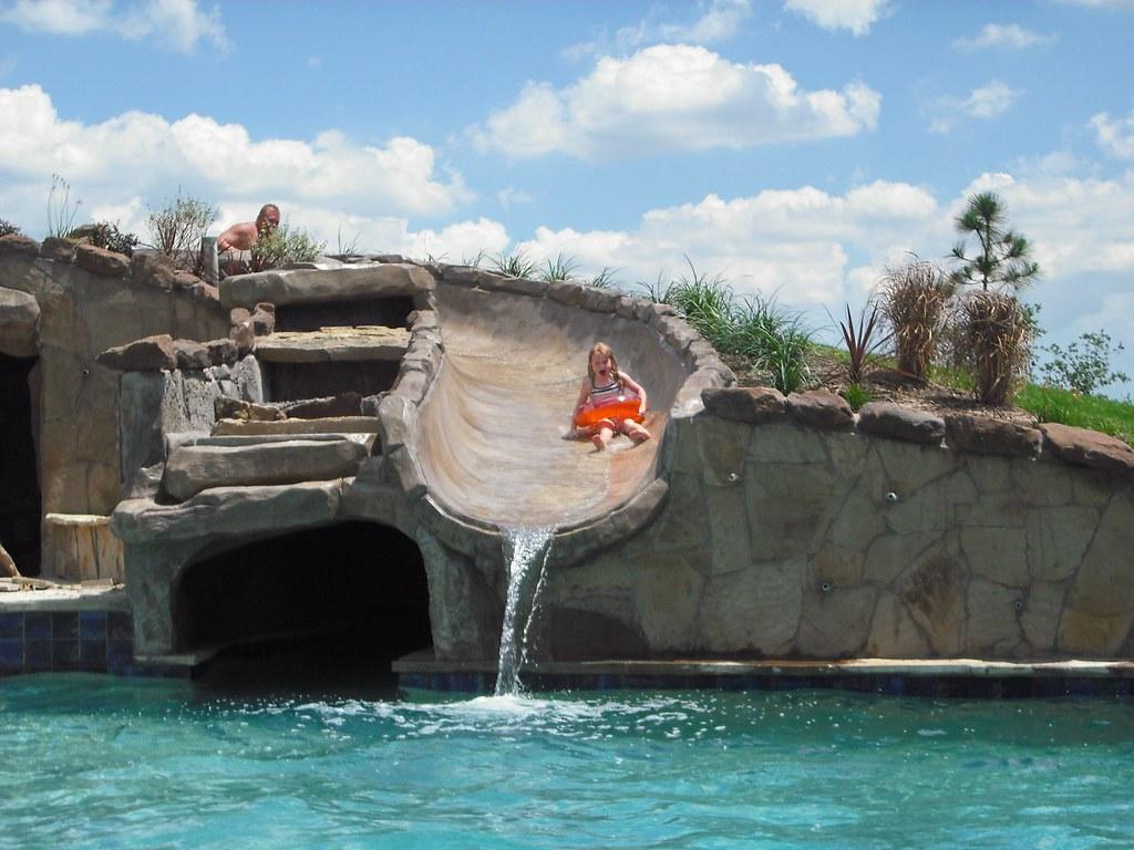 ... elitepoolsofhouston Elite Pools and Spas Giant Water Slide   by  elitepoolsofhouston - Elite Pools And Spas Giant Water Slide Her Face Says It Al… Flickr