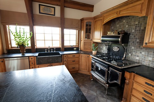 Mountain style post beam kitchen yankee barn homes for Post and beam kitchen ideas