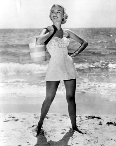 A fashion model in swimsuit poses on the beach | by State Library and Archives of Florida
