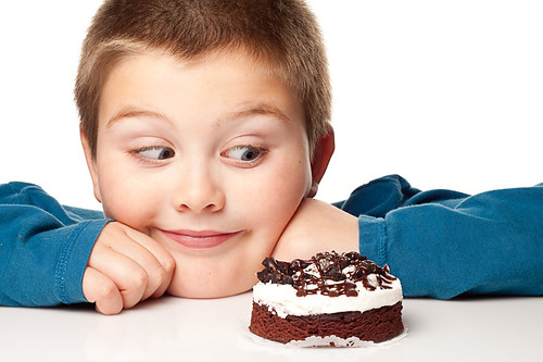 Young boy deciding to eat a dessert | by Pinnacle-Photography