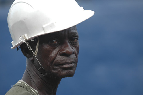 African worker with helmet | by World Bank Photo Collection