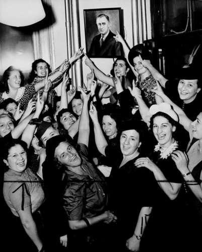 A group of women from ILGWU Local 62 indicate their choice for president by pointing to a picture of Franklin Delano Roosevelt. | by Kheel Center, Cornell University Library