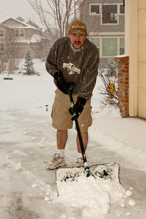 Shoveling snow in shorts and sneakers | by mhedstrom