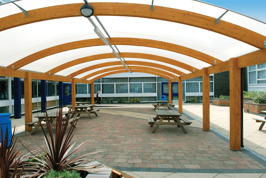 By A Large Span Timber Canopy Creates Sheltered Social And Outdoor Space