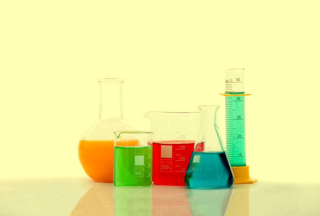 chemistry bottles with liquid inside