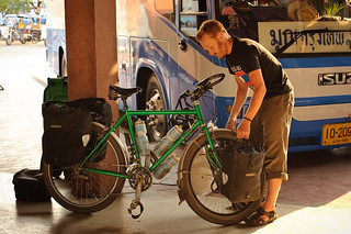 Tyler Removing Panniers at Bus Station | by goingslowly
