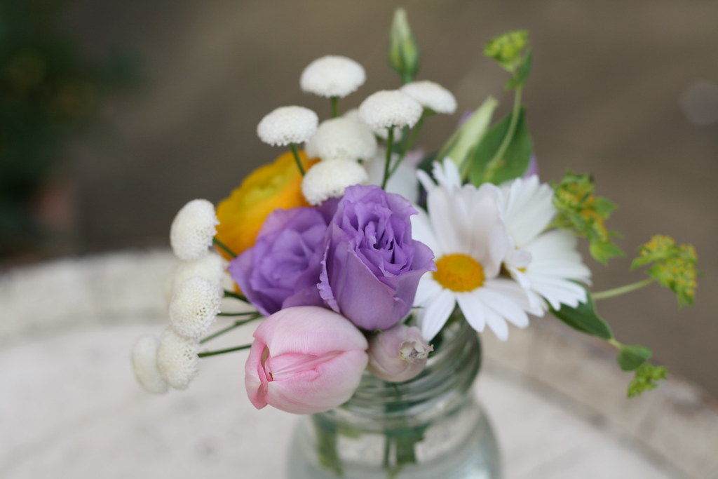 Bright Quirky Spring Flowers In Jam Jars View More Of Our Flickr