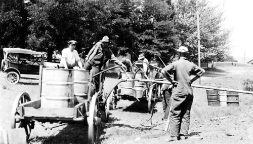 Men filling up oil drums, Sherman County, ca. 1919 | by OSU Special Collections & Archives : Commons
