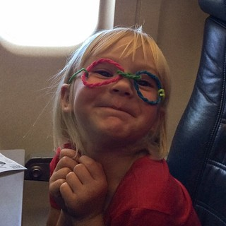 New glasses, Elliora? (Wiki Stix came in the kids' picnic pack on the plane.) | by bethany actually