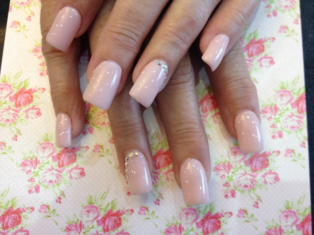 Acrylic Nails With Pinky Nude Gel Polish And Swarovski Crystals On Ring Finger