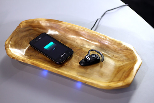 Phone Charging Wirelessly on a Wood Surface | by ecoupled