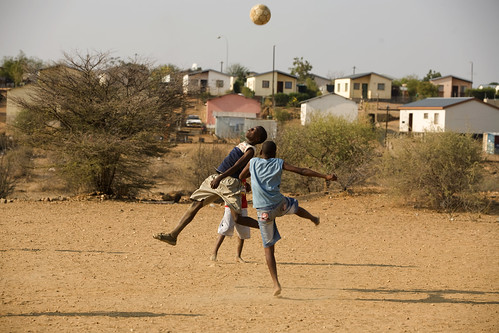 Young boys play soccer | by World Bank Photo Collection