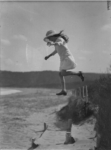 Unidentified small girl leaping onto the beach, c. 1930s, by Sam Hood | by State Library of New South Wales collection