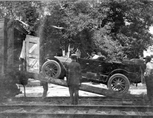 Car being loaded onto a train at De Leon Springs for a trip to Buffalo, New York | by State Library and Archives of Florida