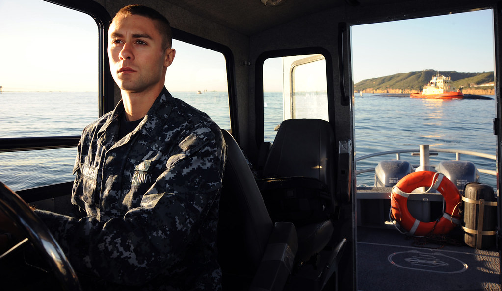 By Official U S Navy Imagery Sailor Escorts A Submarine Through The San Diego Harbor By Official U S Navy Imagery