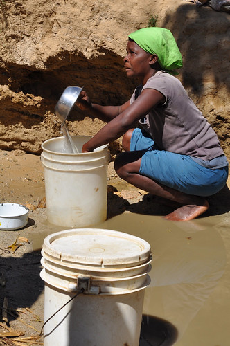 Collecting water from the sand | by waterdotorg