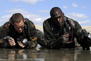 Sailors participate in a swimmer surf passage exercise. | by Official U.S. Navy Imagery