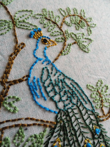 Peacock head embroidery close up | by girlwhoknits