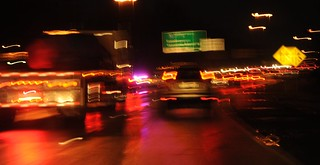 Pink & purple emergency lights - Seattle police at work in the thick of traffic, Highway 5 headed north, truck, suv, car lights, traffic signs, exit signs, commute, North Seattle, Washington, USA | by Wonderlane