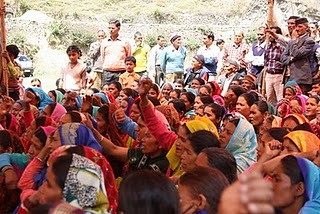 Villagers protest at a public hearing.