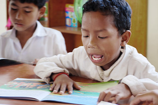 A boy reading book in school librar | by Chea Phal