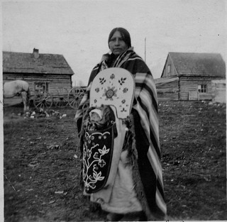 Woman (Salish) with infant in cradle board, 1917 | by Marquette University Archives