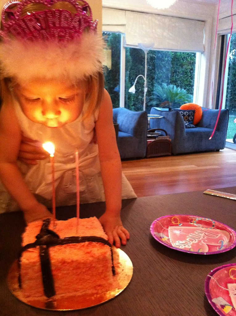 Elaine Blowing Out The 2 Candles On Her Birthday Cake