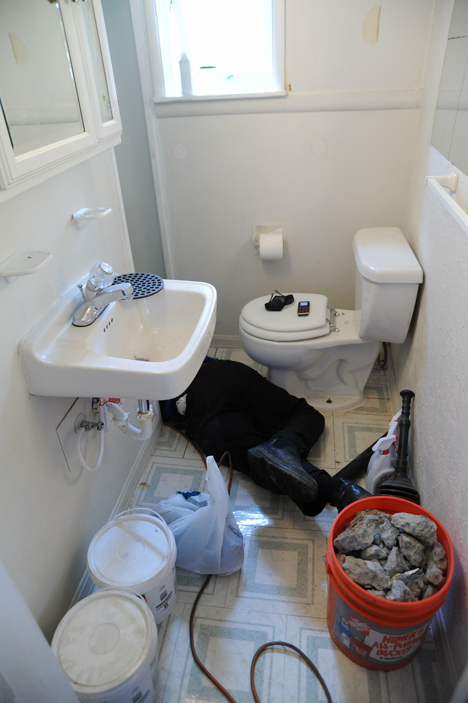 ... George The Plumber Replacing The Broken Sewer Line In The Bathroom  Shower, Concrete Rubble From