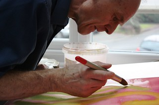 Water-colourist Ian Reynolds working on his art | by RNIB