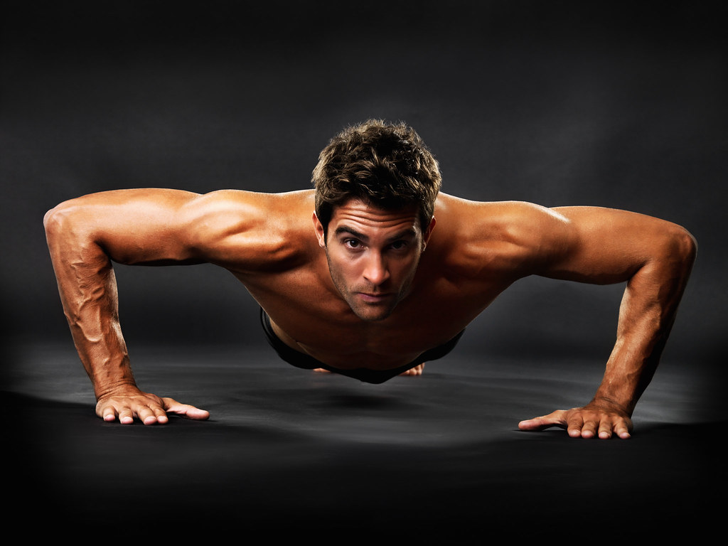 Muscular guy doing pushups