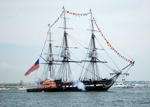 USS Constitution fires a 21-gun salute toward Fort Indepen ...