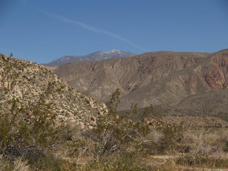 Santa Rosa Mountain and snow-capped Toro Peak in the distance, with flat-topped Monkey Hill on the lower right