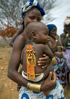 Mucubal baby and his wood talisman - Angola | by Eric Lafforgue