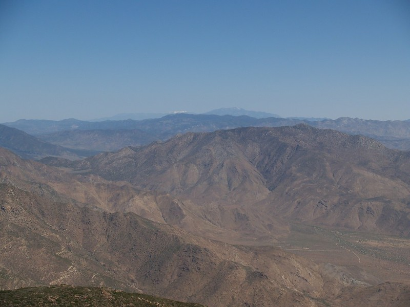 Zoomed-in view looking north to snow-topped San Gorgonio Mountain, San Jacinto Peak, and Granite Peak, foreground