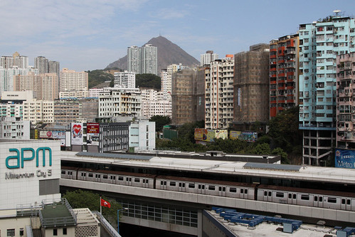 MTR train stopped at the elevated Kwun Tong station