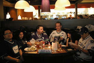 Fans wait for the game to start at the Canucks Tweet-up | by kmaximick
