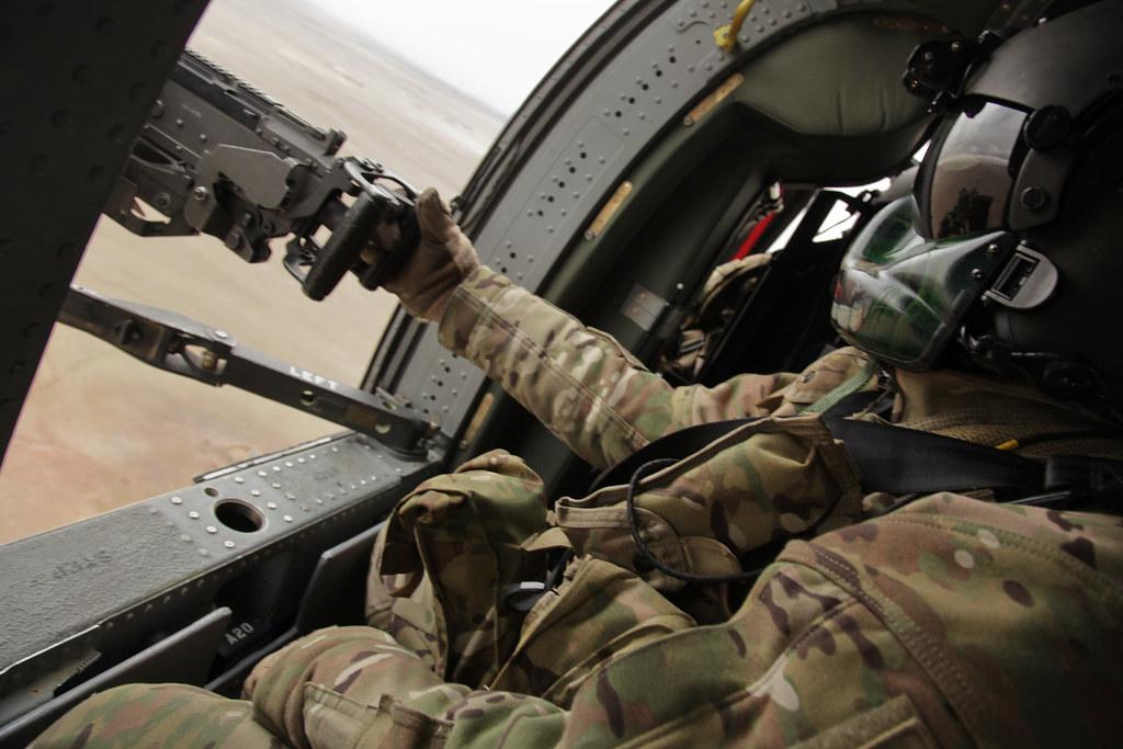 ... Black Hawk door gunner | by jeromestarkey & Black Hawk door gunner | An American army door gunner in a B\u2026 | Flickr