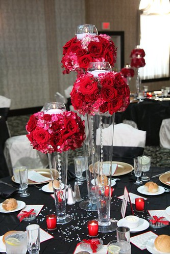Tall jar centerpieces with red flowers rayna brown flickr