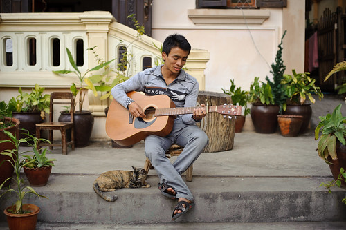Thida Guesthouse Employee Playing Guitar | by goingslowly