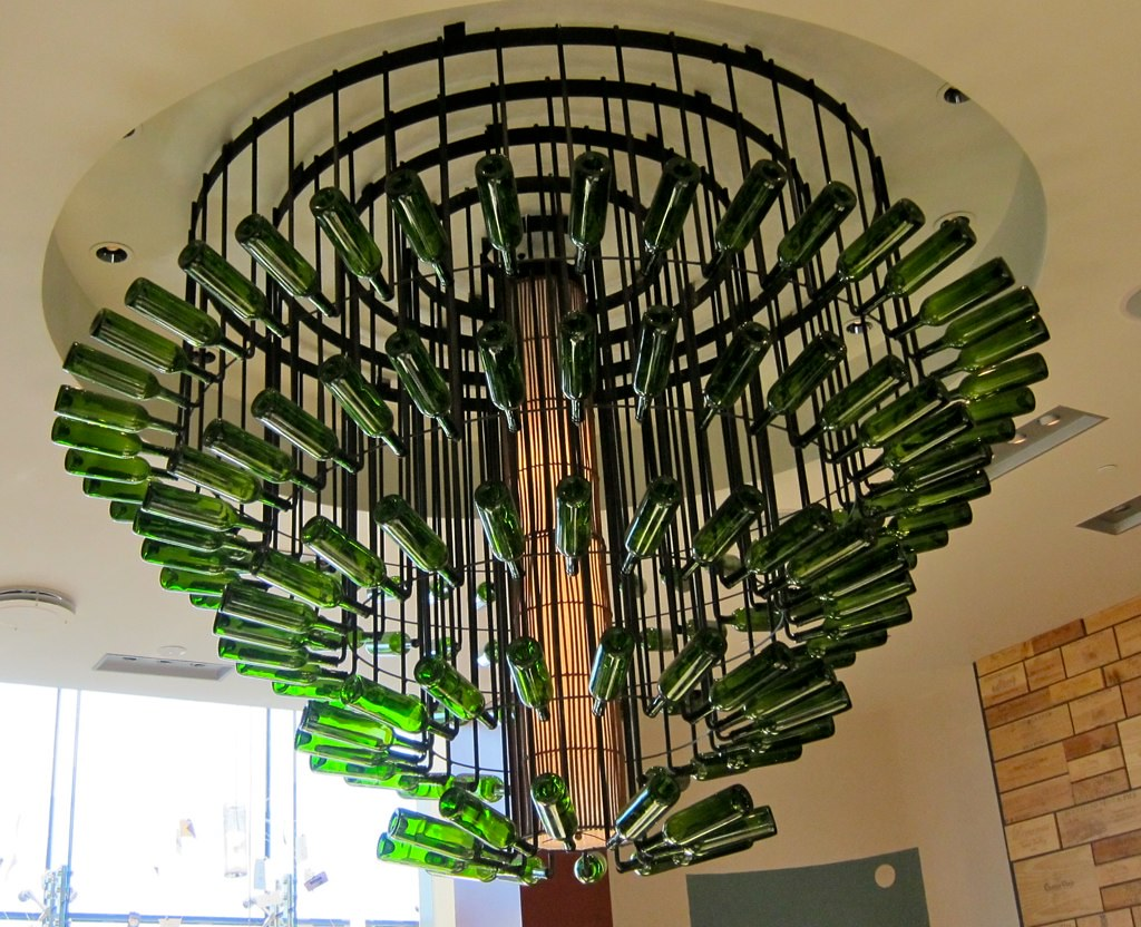 Wine bottle chandelier this huge chandelier hangs in the d flickr wine bottle chandelier by elizabeth condelli escape artists aloadofball