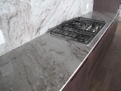 Granite slab kitchen counter tops with full height backspl Flickr