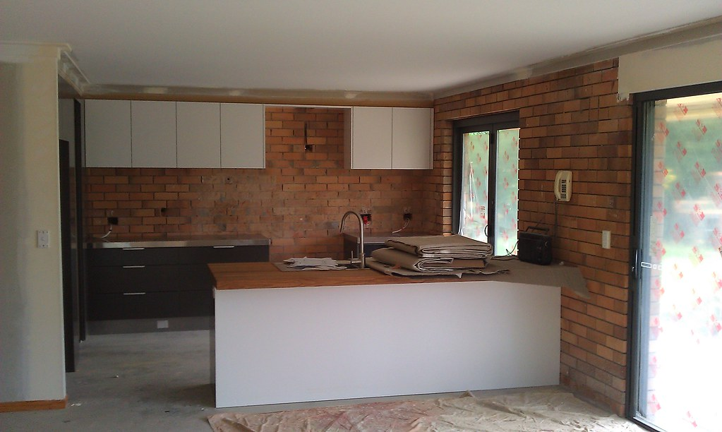 ... Photo Of The Kitchen, Stainless Steel Benches And Solid Oiled Timber  Next To The Sink