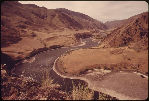 "Winding course of the Snake River viewed from trail near ""Suicide Point"" in Hells Canyon, wildest and deepest gorge in North America, 05/1973 