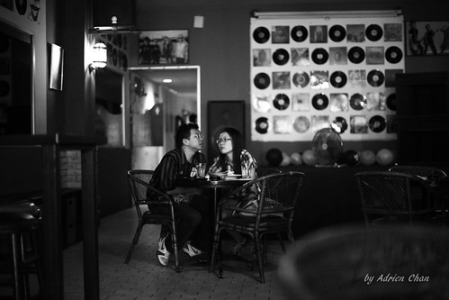 Couple at the pub | by Adrien Chan