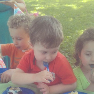 KFP enjoys cake at his birthday party.