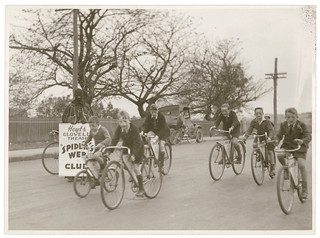 "Boys of Hoyts Clovelly Theatre ""Spider's Web"" Club ride their bikes while ""Spiderman"" looks on, by Sam Hood 