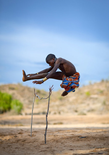 Mukubal Kid Doing High Jumping, Angola | by Eric Lafforgue