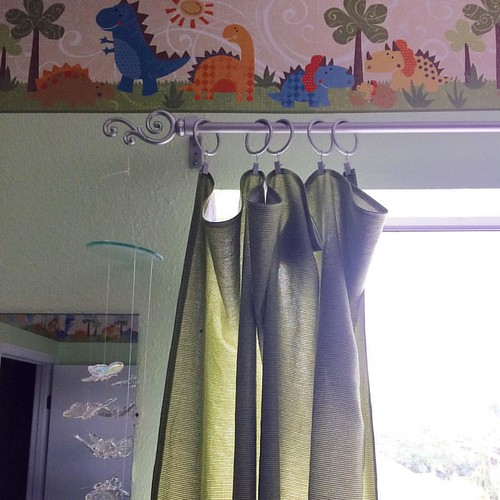 Made some green curtains for the nursery to match the dinosaur border. 💚