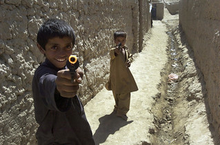 Boys Play with Toy Guns in Bagram, Afghanistan | by United Nations Photo